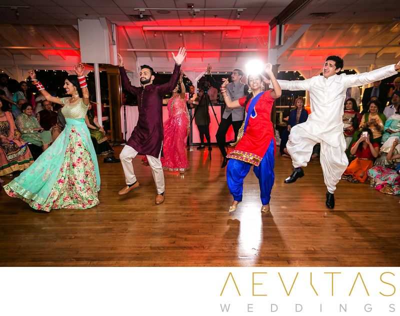 Couple and guests dancing at Indian Sangeet party