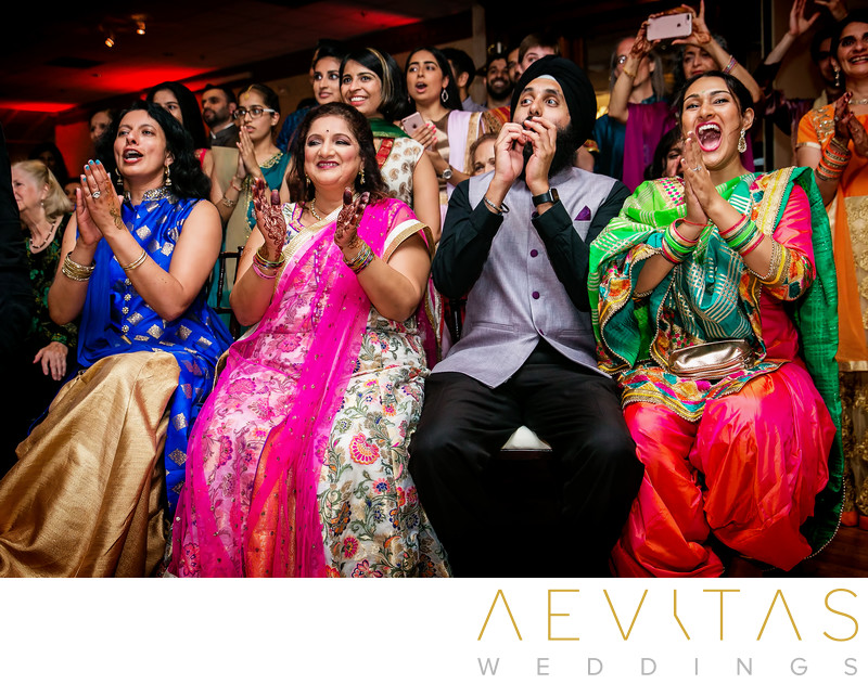 Family members clapping at Indian Sangeet ceremony