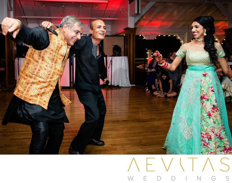 Father dancing with bride at Indian Sangeet party