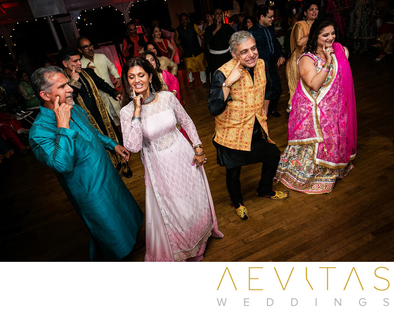 Parents and friends dancing at Indian Sangeet party