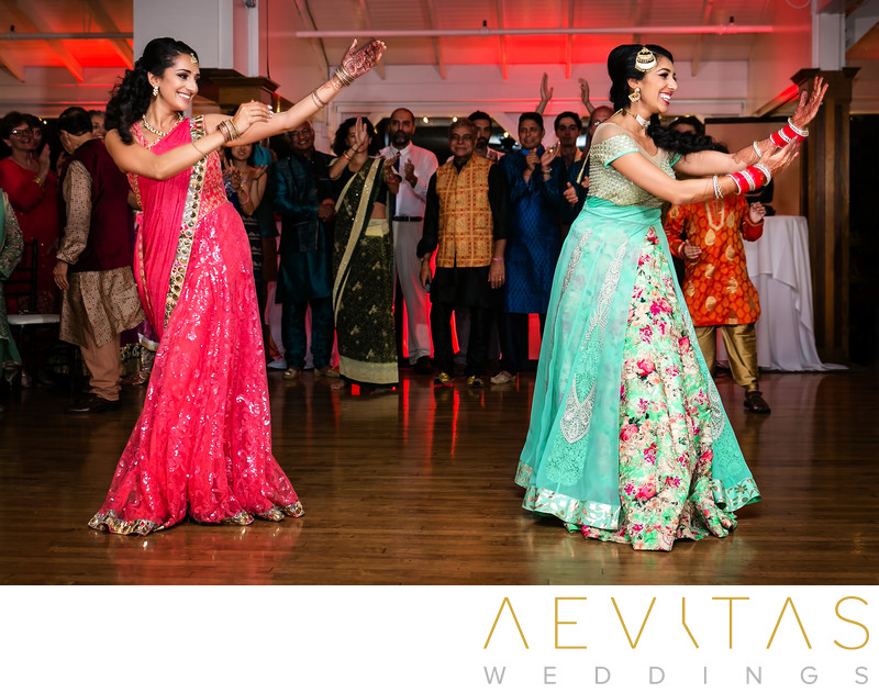 Bride and sister dancing at Indian wedding party in LA