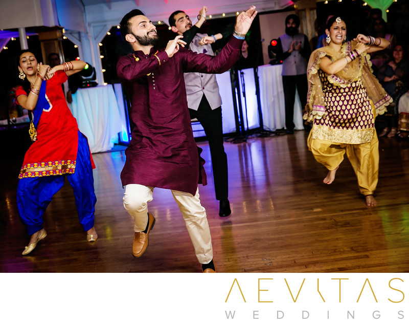 Groom and siblings dance at Indian Sangeet party