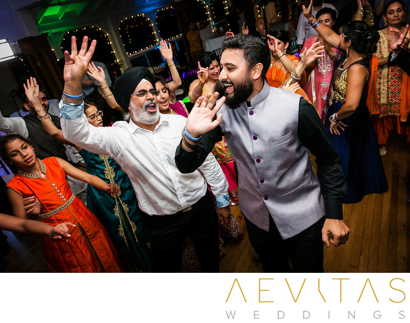 Groomsmen and guests dancing at Indian Sangeet party