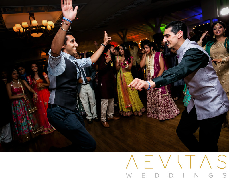 Groomsman and friend dancing at Indian wedding party