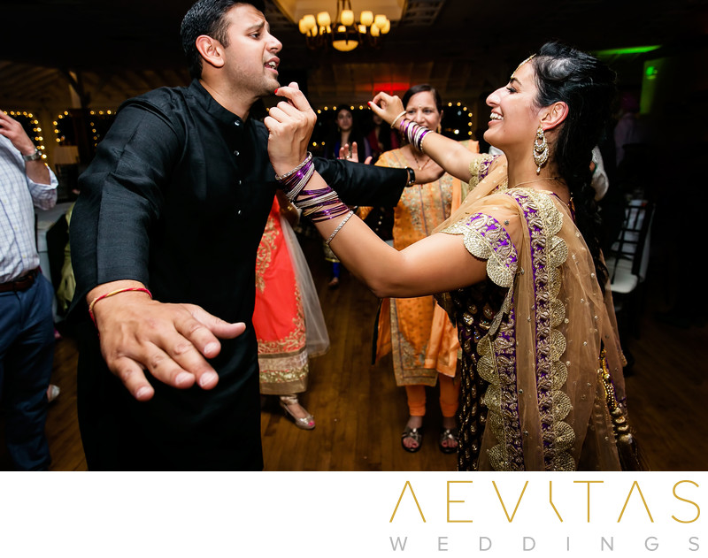 Man and woman dancing at Indian wedding party