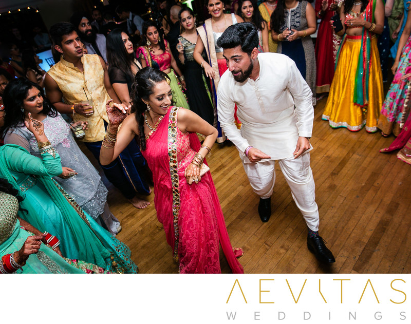 Sister and brother dancing at Indian wedding party