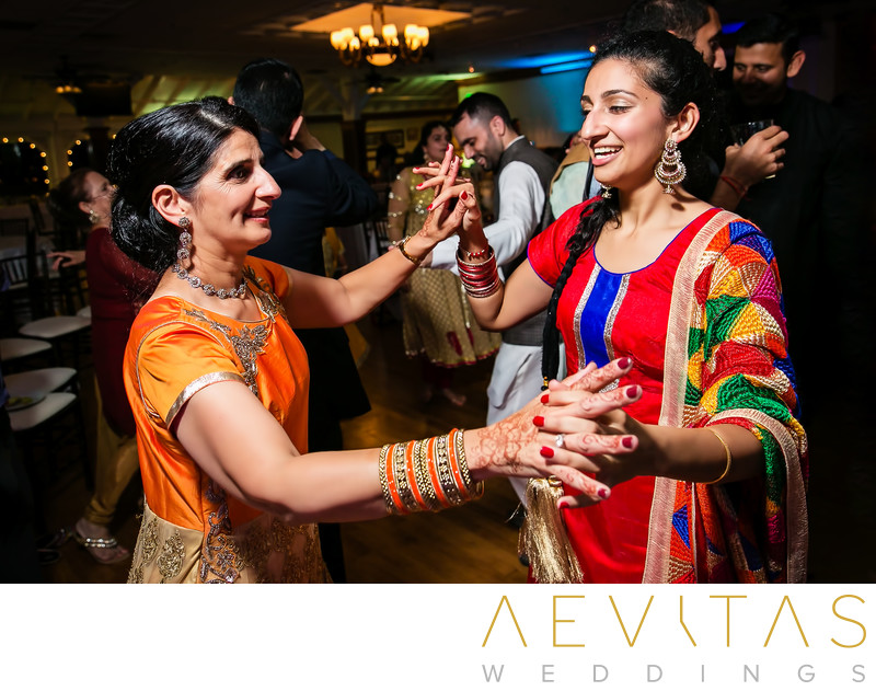 Mother and daughter dancing at Indian Sangeet party