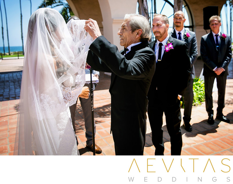 Father lifts bride's veil at Santa Barbara wedding