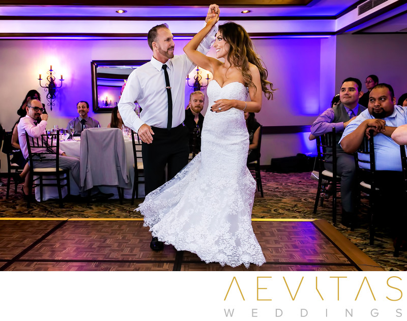 Groom twirls bride at Fess Parker Resort reception