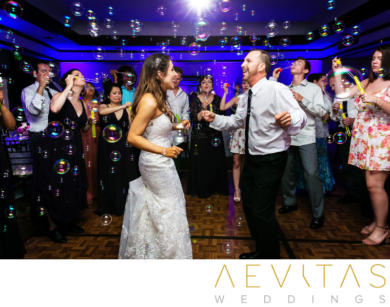 Couple dancing with bubbles at Santa Barbara reception