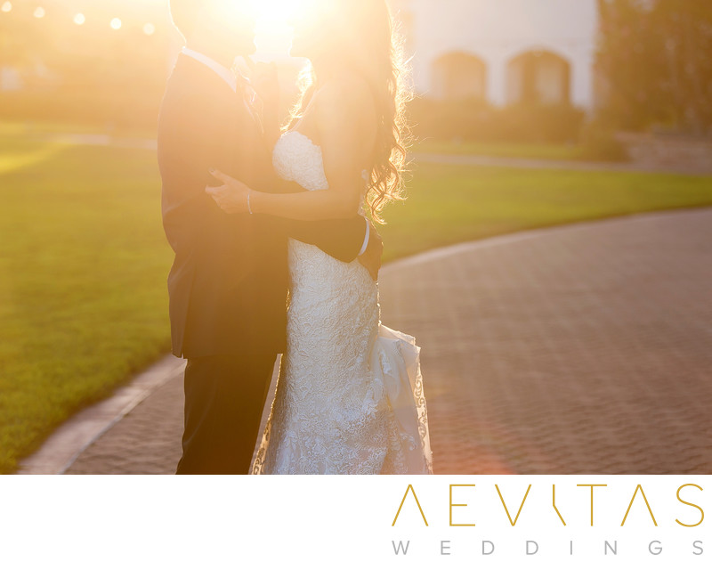 Bride and groom in golden light at Fess Parker Resort