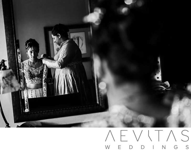 Black and white Indian bride getting ready photo