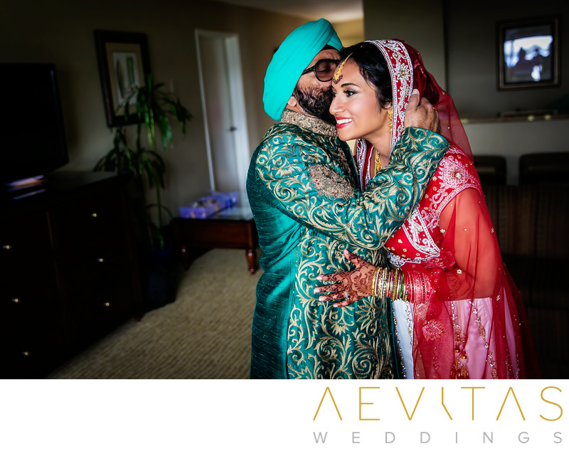 Father embraces bride at Sikh wedding in San Diego