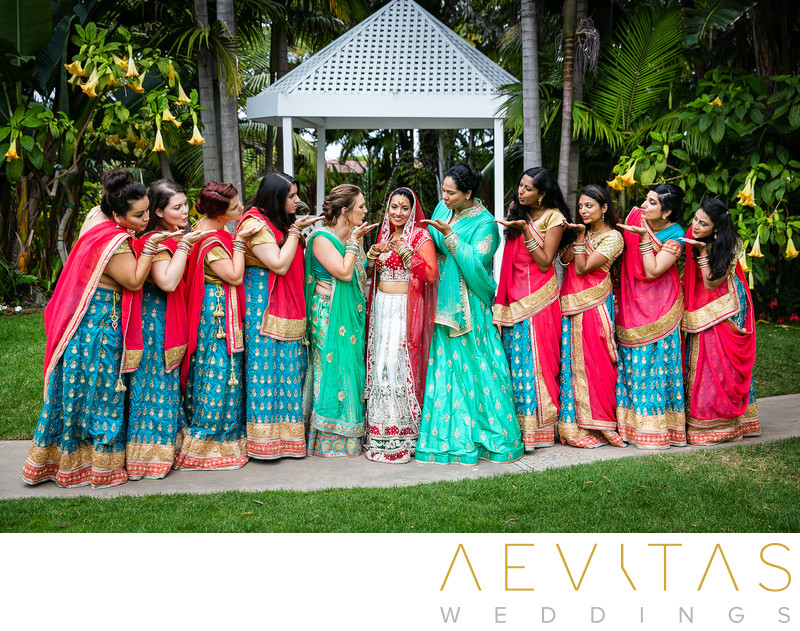 Bridesmaids blowing kisses to Indian bride at wedding