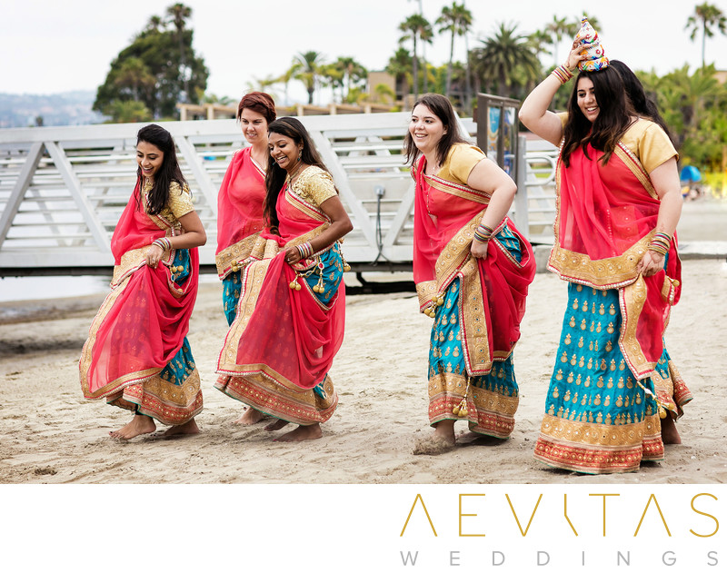 Bridesmaids dancing at Indian beach wedding, San Diego
