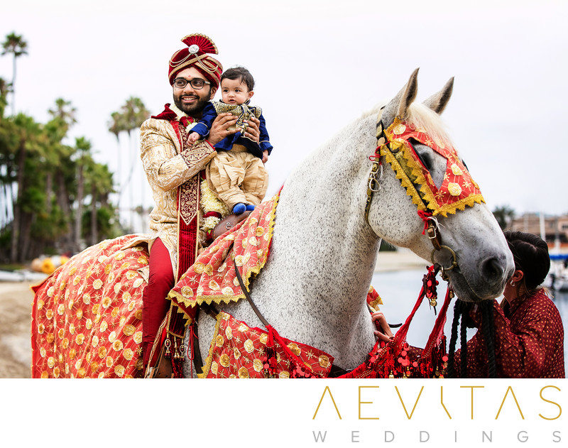 Groom and toddler on horse at Indian wedding