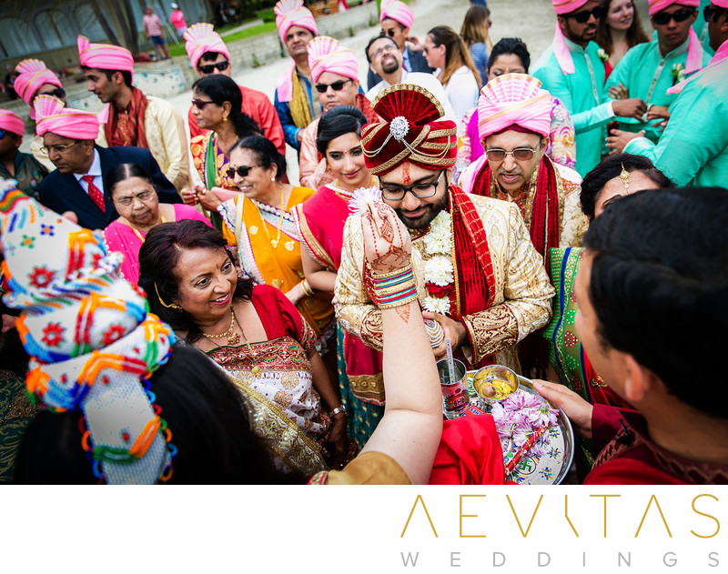 Groom performing ritual at Indian wedding in San Diego