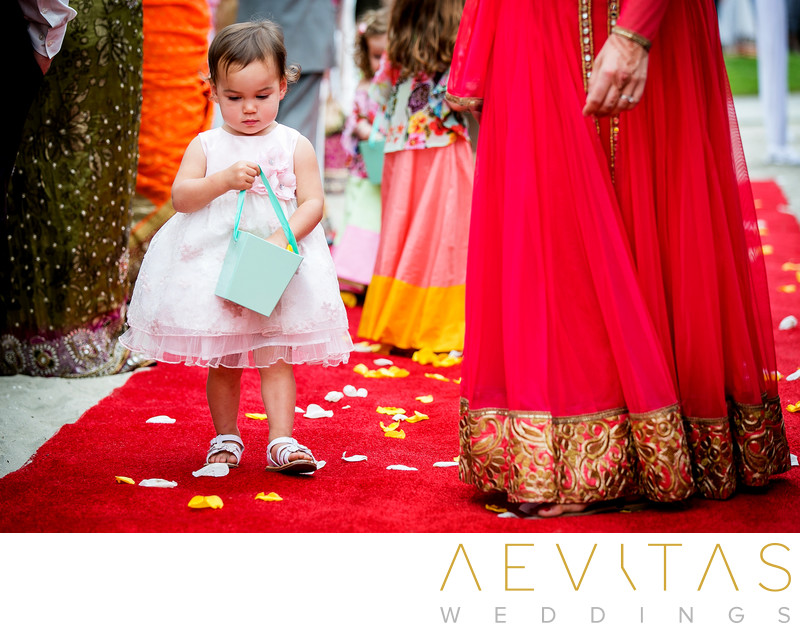 Cute flower girl at Indian wedding in San Diego