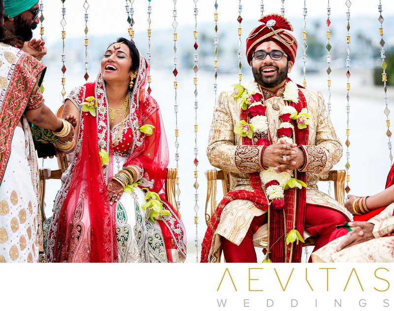 Bride and groom laughing at Indian wedding ceremony