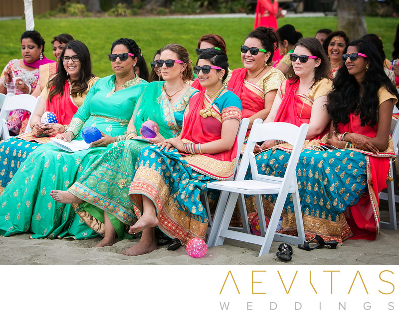 Bridesmaids wearing sunglasses at Indian wedding
