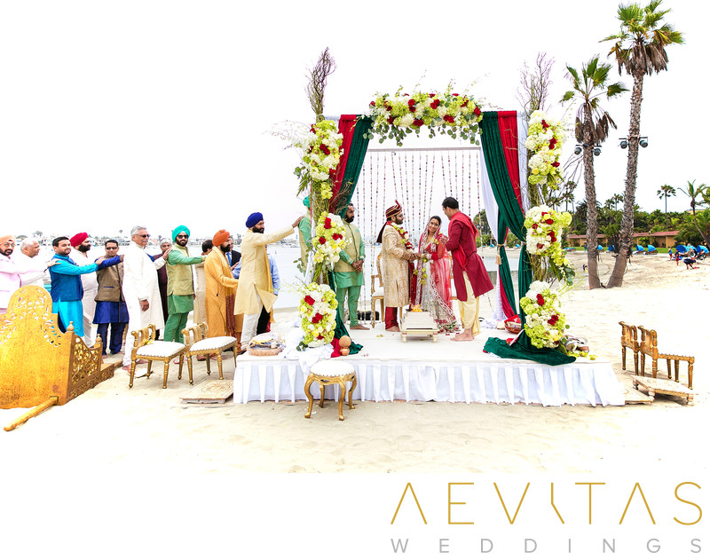 Mandap stage and Indian wedding guests in San Diego