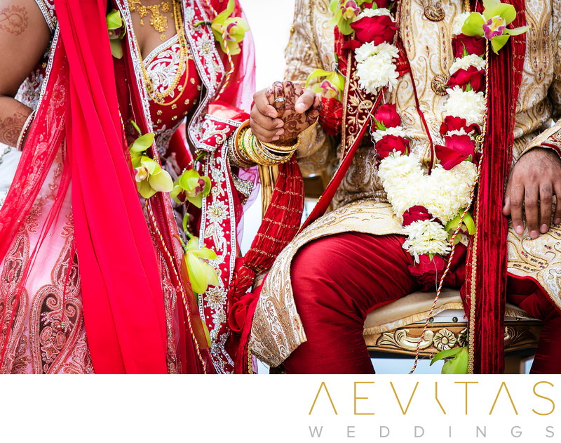 Close-up of couple holding hands at Indian wedding