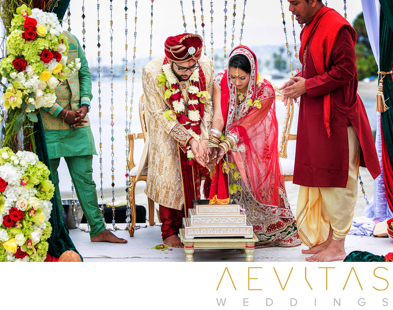 Couple perform traditional Indian wedding ritual