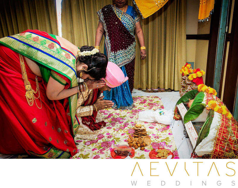 Couple bow and make offerings at Indian wedding