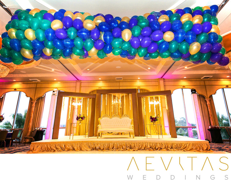 Balloons above stage at Bahia Resort Hotel reception