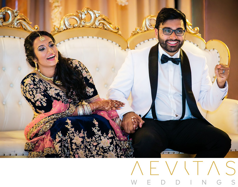 Candid couple wedding photo on white and gold sofa