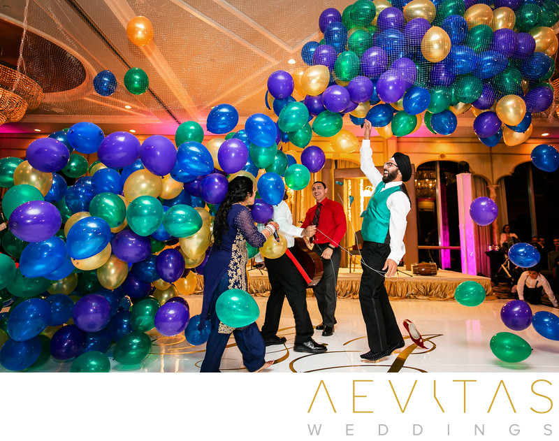 Balloons falling on dance floor at Bahia Resort Hotel