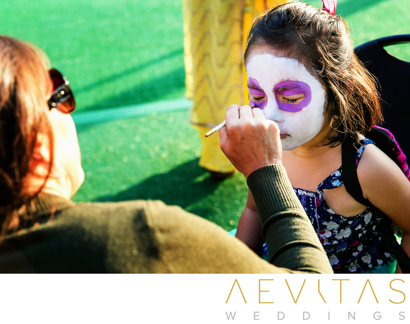 Wedding guests having face painted in San Diego