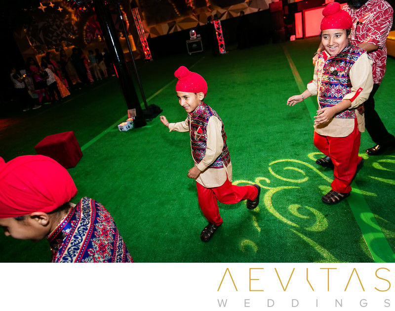 Young Sikh boys dancing at Indian wedding reception