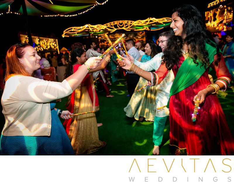 Wedding guests stick dancing at Indian party, San Diego