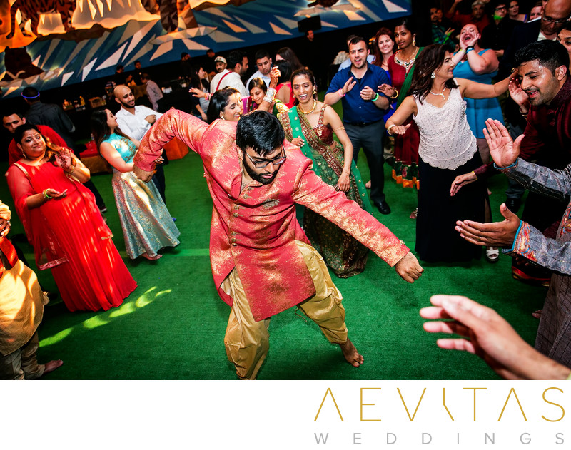 Groom dancing action shot at Indian wedding