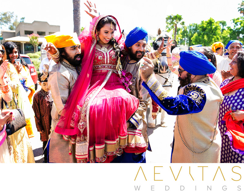 Indian bride carried through streets of San Diego