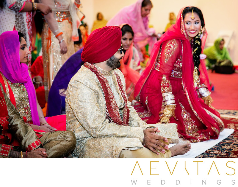 Bride smiles at groom during Sikh wedding in San Diego