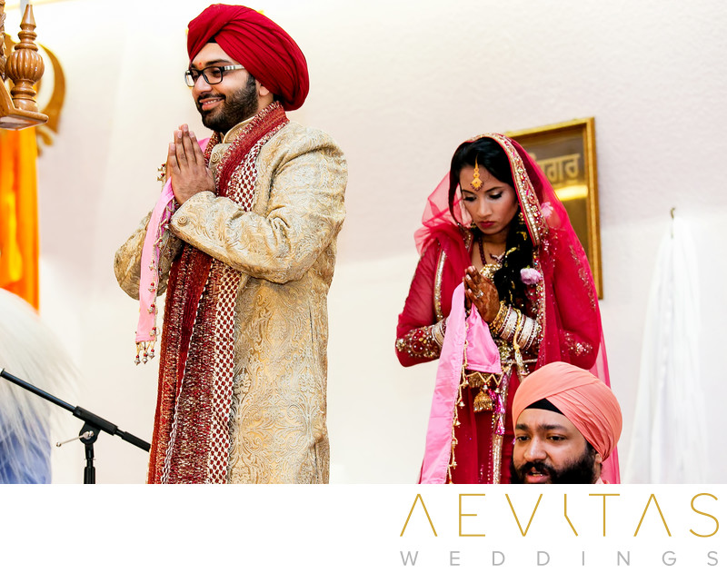 Groom and bride pray at Sikh Gurdwara Temple