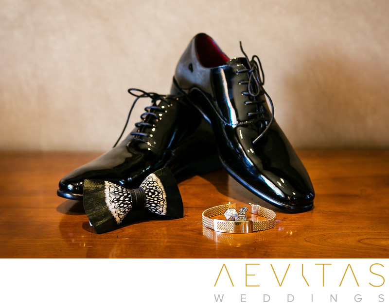 Groom shoes, watch and bow tie details photo