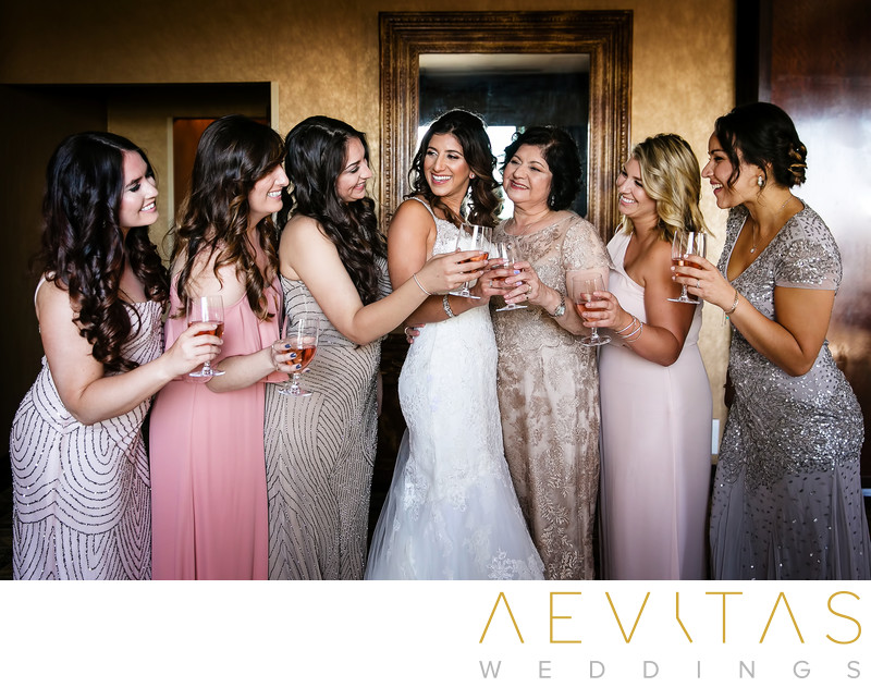 Bride toasting with bridesmaids in Century City hotel