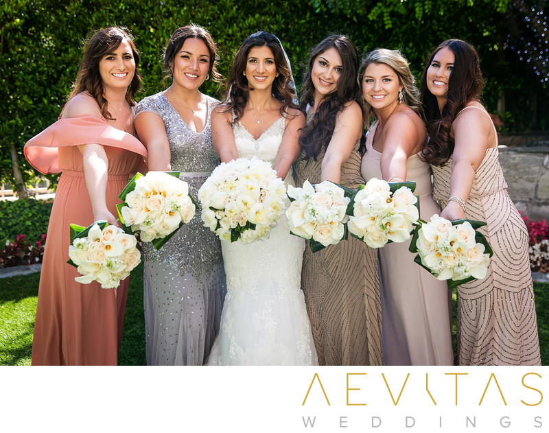Bride and bridesmaids with floral bouquets in LA
