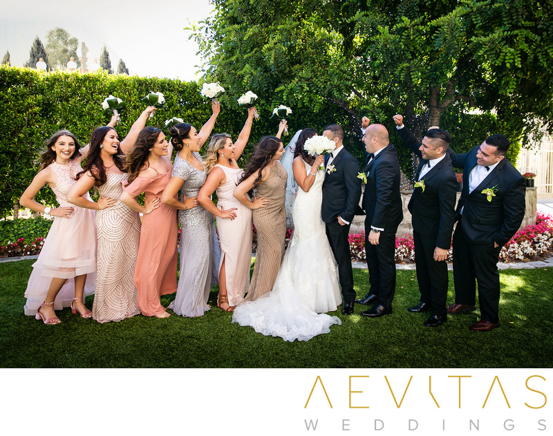 Couple kiss bridal party portrait in Los Angeles