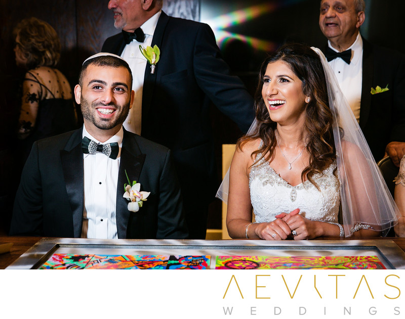 Bride and groom signing Ketubah in Century City