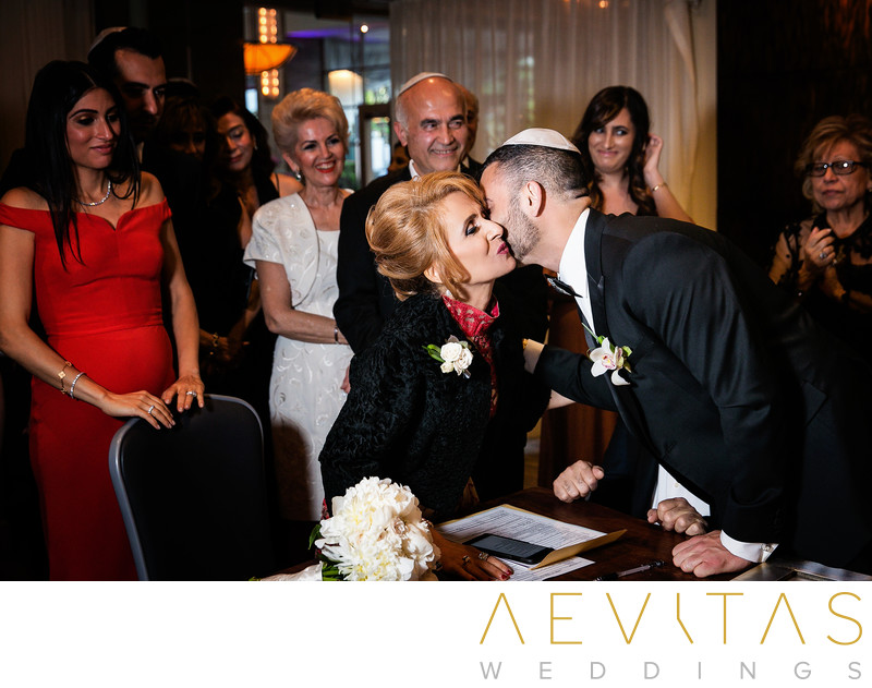 Groom kisses mom at Jewish wedding in Los Angeles