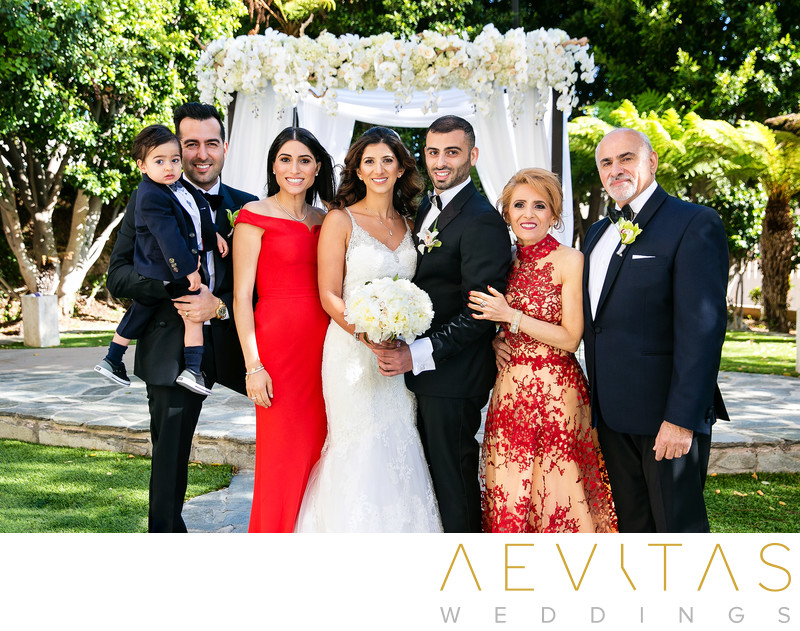 Couple with family portrait at Century City wedding