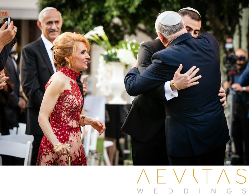 Groom hugs dad at Jewish wedding in Century City