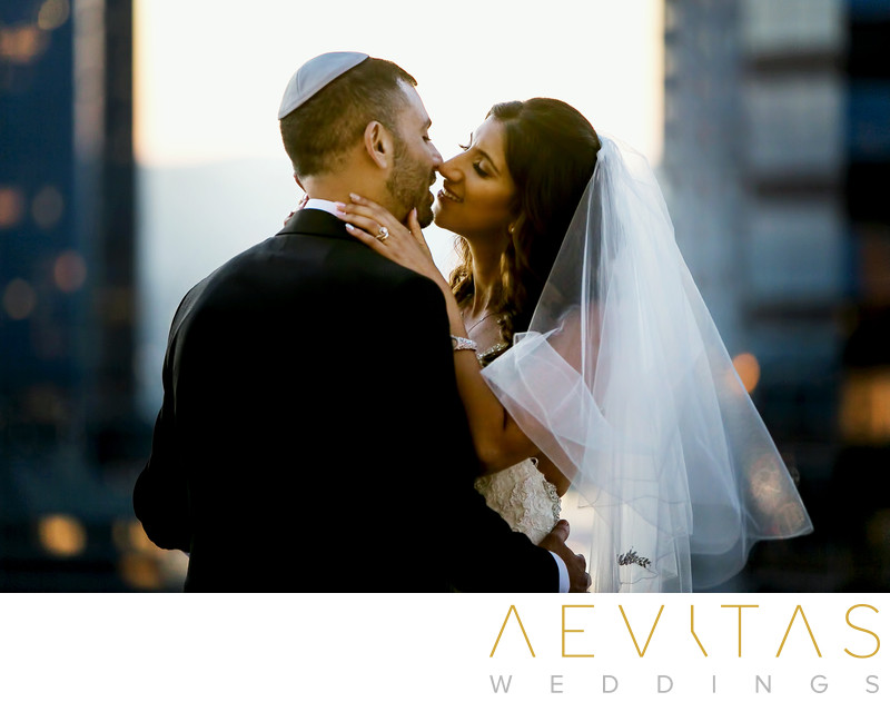 Couple kiss by Los Angeles wedding photographer