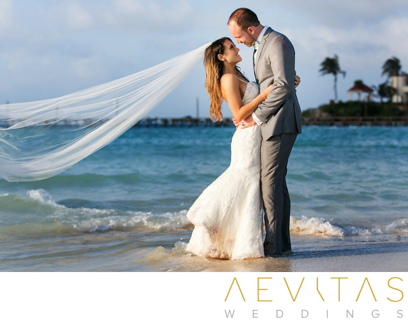 Beautiful couple portrait with Caribbean Sea in Mexico