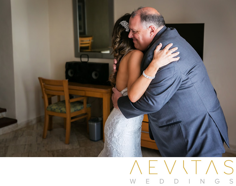 Bride embraces dad during father-daughter first look