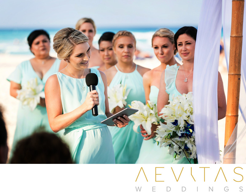 Bridesmaid reading during Cancun beach wedding ceremony
